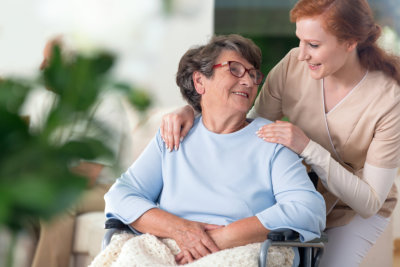 caregiver with patient smiling