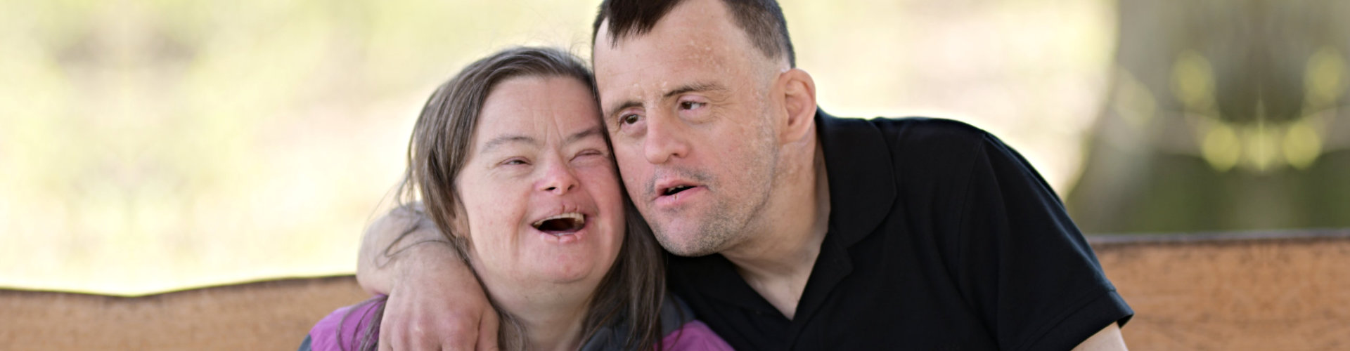 couple with down syndrome smiling