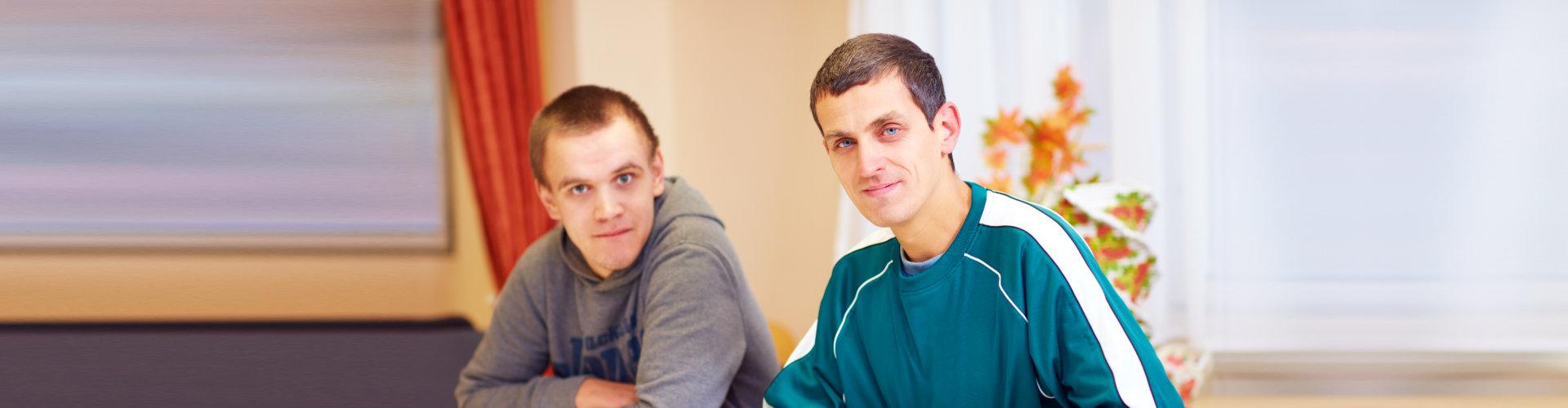 two men smiling