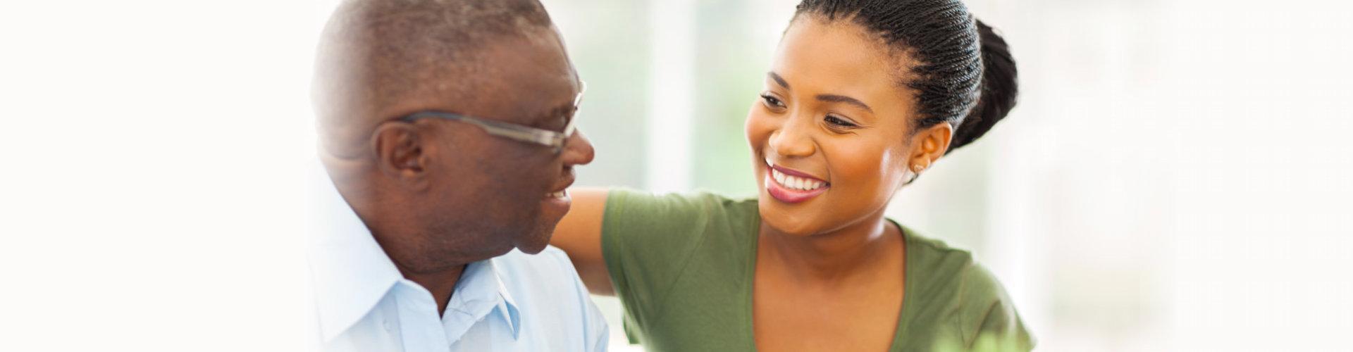 caregiver comforting the elder man